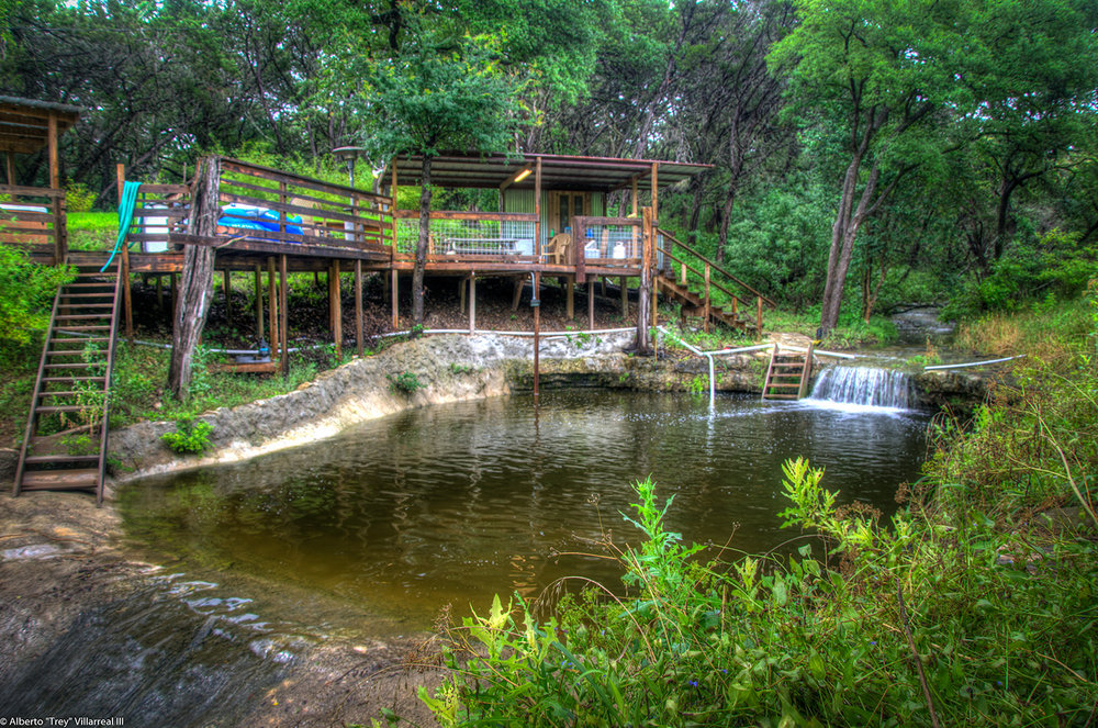 Riverhome deck along natural stone pool on River Road, New Braunfels Tx.