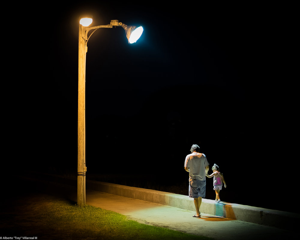 Night time stroll between Grandfather and Granddaughter