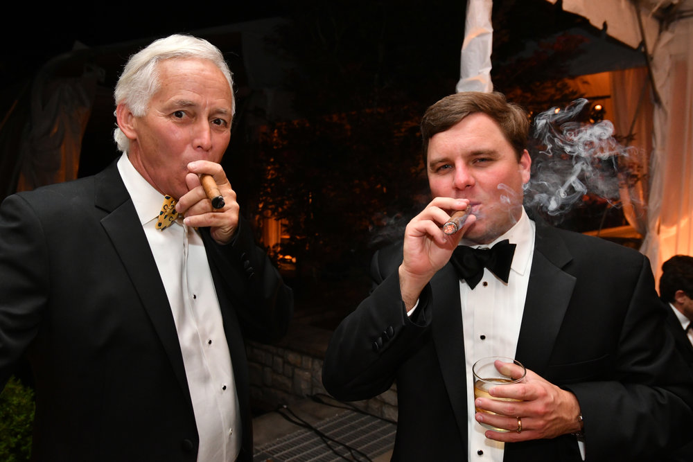 Guests enjoy cigars in the Smokin' Hotz lounge.JPG