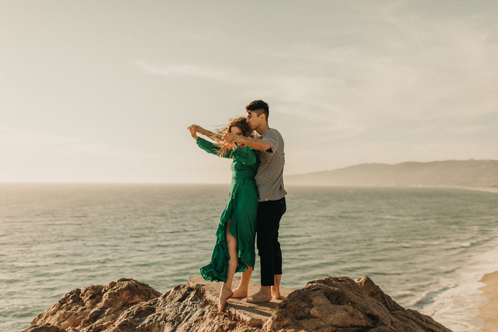 malibu-point-dume-green-dress-cliff-ocean-rocks-engagment-photos