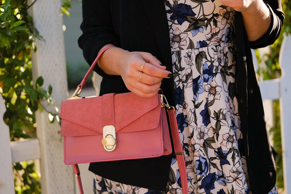 Pink handbag and floral dress creative job interview look