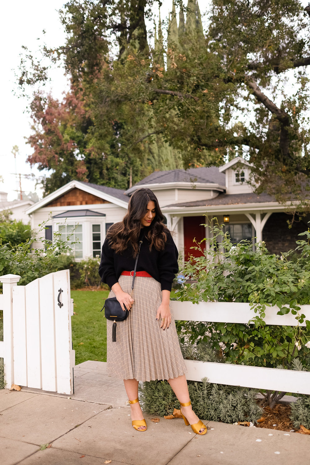 black sweater ASOS pleated skirt yellow shoes