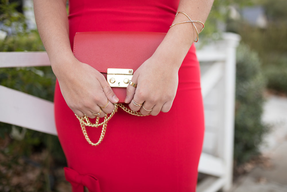 Red dress and red bags with gold jewelry