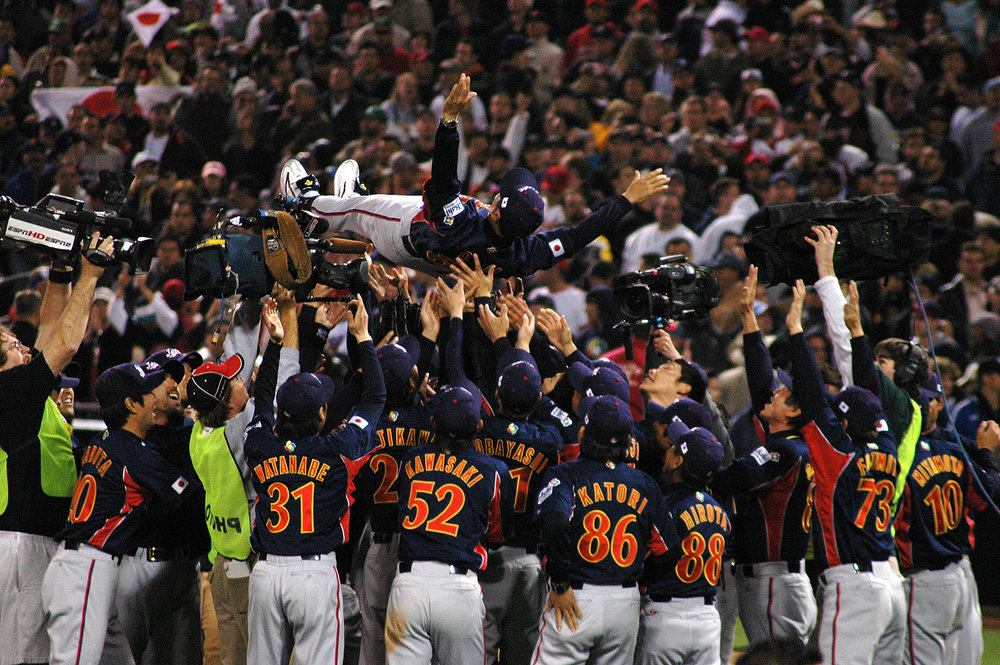 Team Japan celebrates their victory over Cuba in the inagural World Baseball Classic.