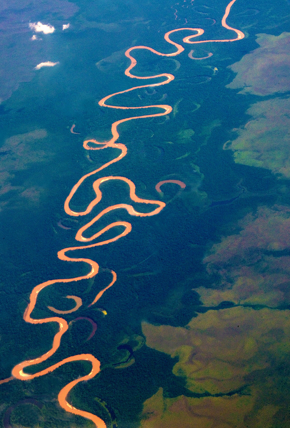 "Flying over the Amazon Rainforest is an experience that will leave you in sheer awe, and will inspire you to better understand and appreciate the importance of this critical Earth ecosystem. Housing over 16,000 different tree species and over 40.000 plant species, the Amazon is the terrestrial ""lungs of our planet"". It produces 20% of Earth's oxygen while absorbing and storing more carbon dioxide than any other terrestrial ecosystem on our planet. It is home to over 10% of all Earth's known species and 25% of the world's medicinal plants, while producing 25% of the planet's fresh river water. While deforestation in 2012 had been slowed to its lowest point in 25 years due to spirited conservation efforts, it has been on the rise again in recent years, with 2016 seeing a 75% increase in Amazon deforestation from its 2012 level. Overall, more than 20% of the Amazon Rainforest has been destroyed."