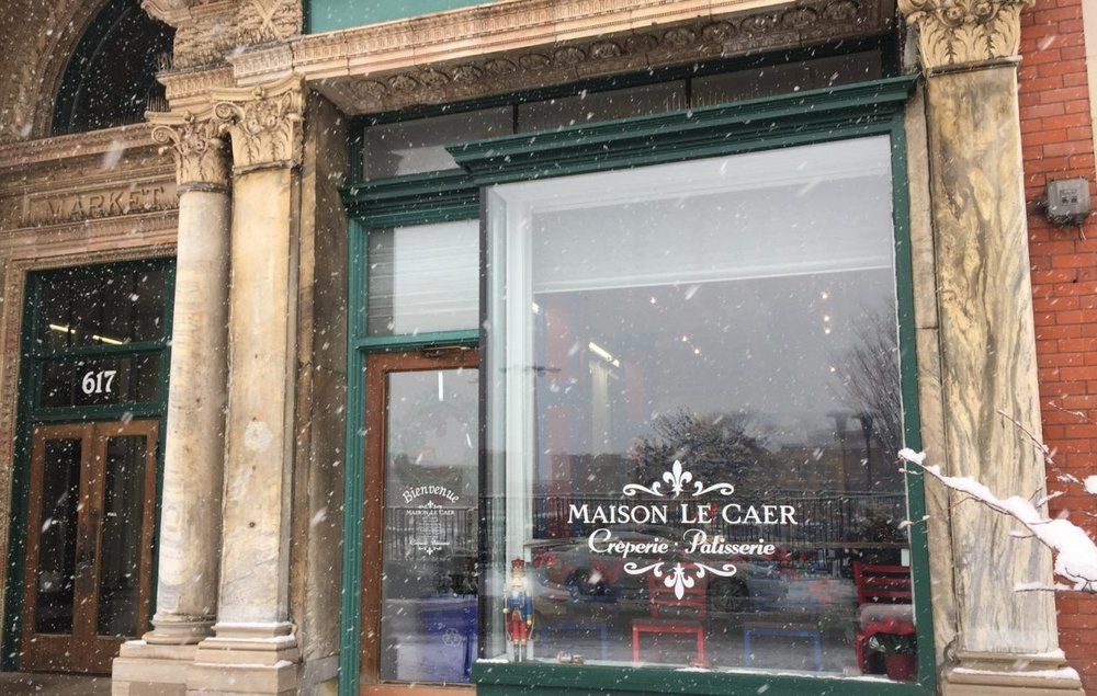 French pastry chef Camille Le Caer is opening his second Maison Le Caer location in the historic building, an ornate, three-story space that runs from 617 Main St. through to Washington Street. The cafe has entrances from the street and the building's central hall. — gusto, Buffalo News, November 2018 - French crêperie-cafe sets Market Arcade opening