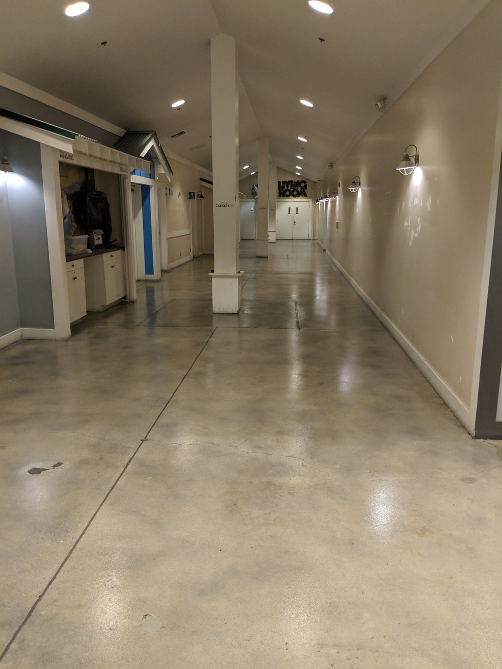 Check out these amazing floors! Ground down to perfection, stained grey to camouflage the cracks and different concrete patches, then sealed with an anti-slip clear coat. By now, these hallways have been painted by our wonderful volunteers! You won't recognize it when we're done…