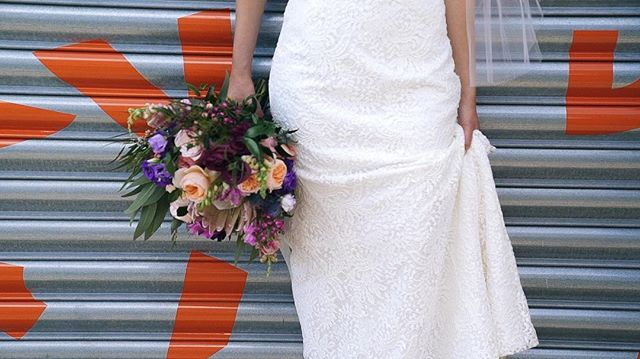 Train in one hand, blooms in the other- another bride ready to take on the world with her trusty sidekick (not pictured).