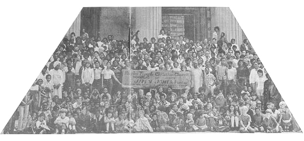Peoples Temple members gathered with a banner advertising Jim Jones and Peoples Temple in San Francisco 1972. Photo courtesy of Laura Johnston Kohl via Peoples Temple/Jonestown Gallery (Flickr)