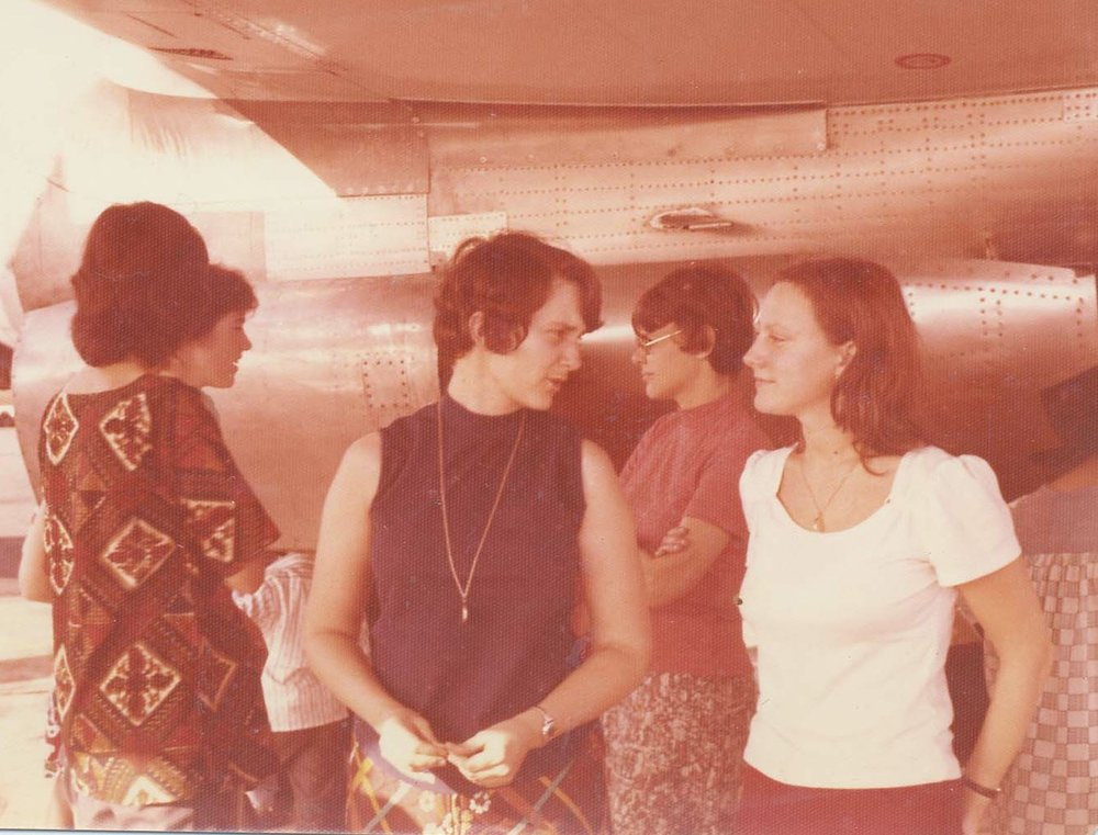 Laura Johnston Kohl (center) with other Peoples Temple members during a refueling stop on the way to Guyana in 1974.  Photo courtesy of Laura Johnston Kohl via Peoples Temple/Jonestown Gallery (Flickr)