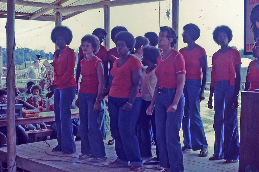 Laura Johnston Kohl (far right) performing in Jonestown 1978. Photo courtesy of Laura Johnston Kohl via Peoples Temple/Jonestown Gallery (Flickr)