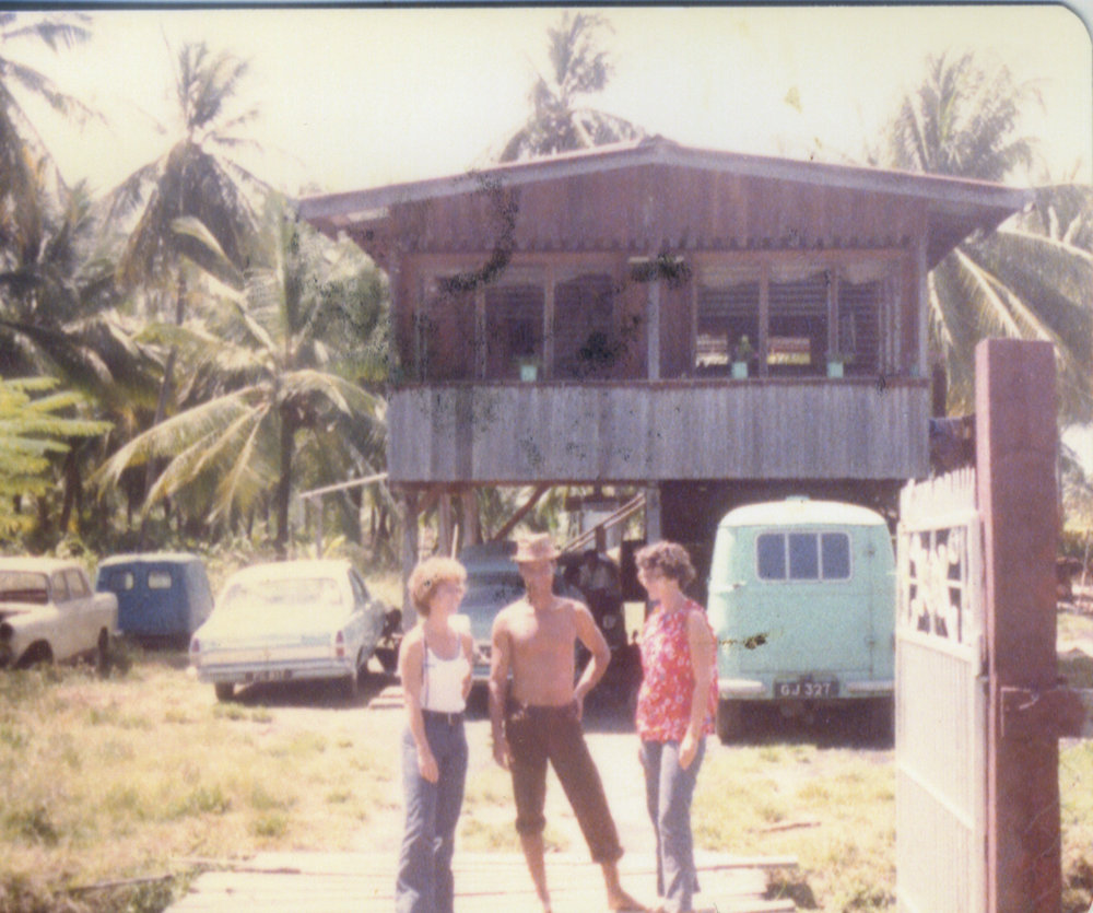 Jonestown victim, Evelyn Leroy and Laura Johnston Kohl (far right) speaking with a Guyanese man in Georgetown 1977. Photo courtesy of Laura Johnston Kohl via Peoples Temple/Jonestown Gallery (Flickr)