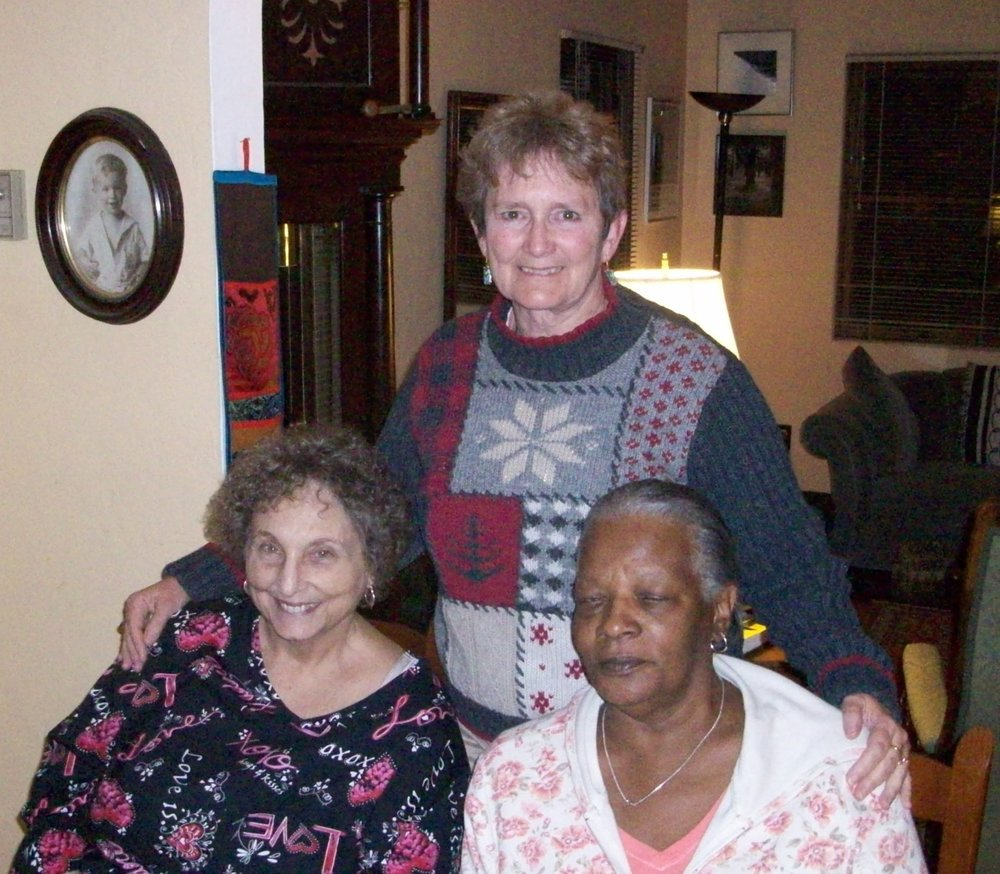 Jonestown survivors Claire Janaro, Juanell Smart (right), Laura Johnston Kohl (standing) celebrate Thanksgiving in 2009. Photo courtesy of Laura Johnston Kohl via Peoples Temple/Jonestown Gallery (Flickr)