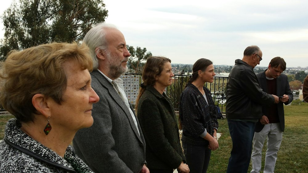 Laura Johnston Kohl (far left) at the 36th anniversary gathering at Evergreen Cemetery in Oakland, CA, on November 18, 2014. Photo courtesy of Laura Johnston Kohl via Peoples Temple/Jonestown Gallery (Flickr)