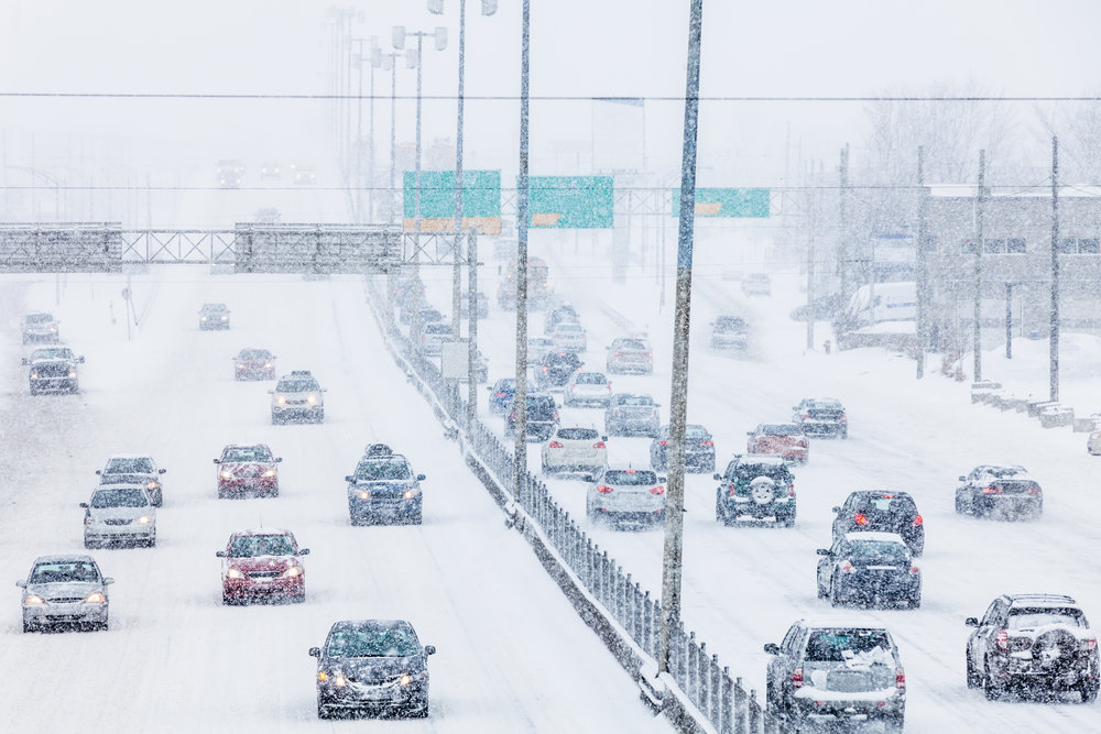 snowstorm-on-the-highway-during-the-rush-hour-PMYGJAG.jpg