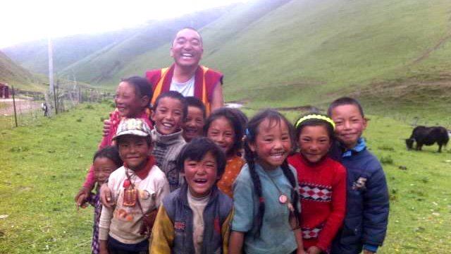 KIDS + MONK TEACHER SMILE.jpg