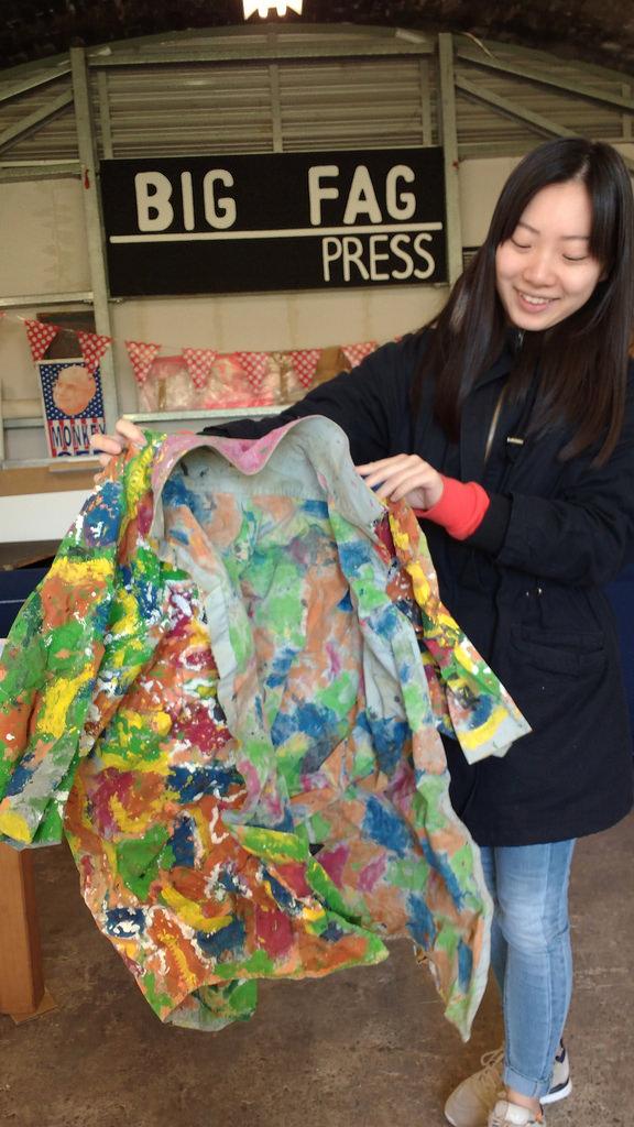 Audrey Qin with a John Demos art shirt at Big Fag Press