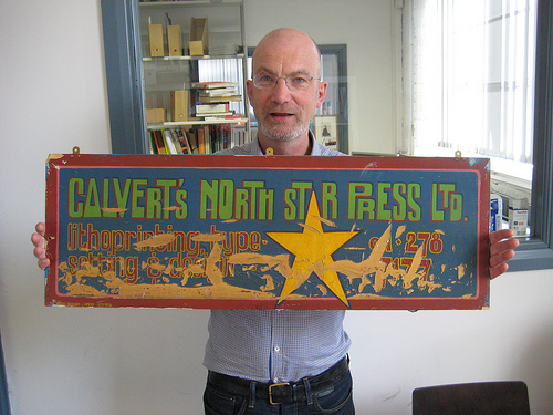 "[Sion from Calverts shows us one of their early hand-painted trade signs – apparently it was called ""north star"" because that was the name of the pub where they had their first meeting!]"