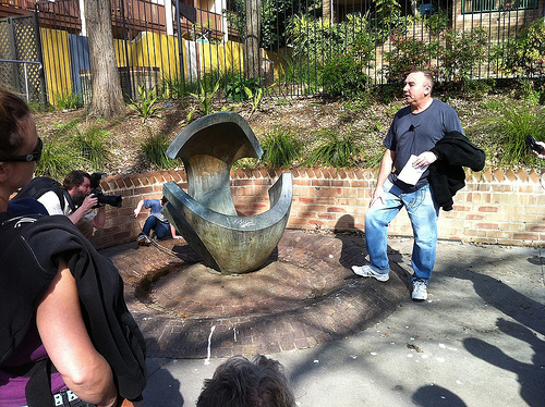 Artist Christopher Dean discusses the sculpture 'Aphrodite' by Margel Hinder, in the park at Sir Dennis Winston Place.