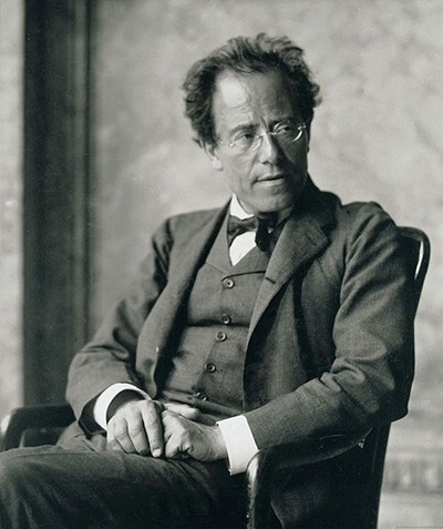 Photograph of  w:Gustav Mahler in the Foyer of the Hofoper, Vienna; this work was published on plate 12 of Richard Specht's   Gustav Mahler  (1913), Berlin and Leipzig: Schuster and Loeffler. This is a studio portrait and the photographer has set up lighting and pose; hence, it is a  lichtbildwerk , photographic work (of art), subject to 70 years pma copyright protection per Austrian law.
