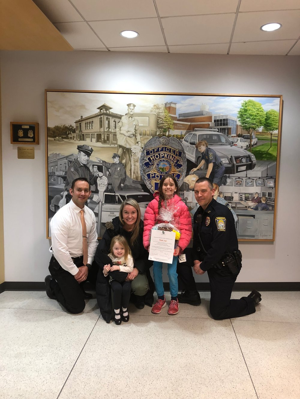 Donating Girl Scout cookies to Hopkins Police Department