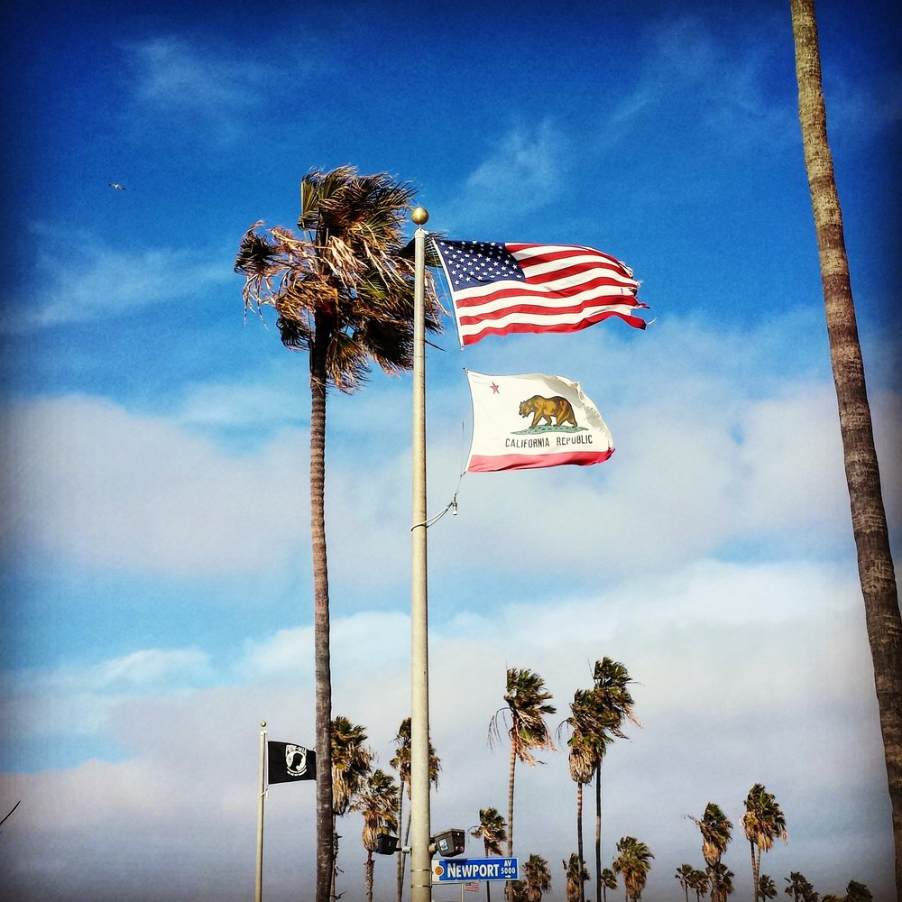 "Today, it's not just time for a personal  So San Diego  picture, but also for honoring and thanking - and most importantly  appreciating  - those who have served or are still serving in the U.S. Armed Forces.     Today is November 11: Veterans Day.    The military is big here in the U.S. - specifically in San Diego as (one of) the biggest military bases, specifically for the Navy (and hence for the Marines). This military, patriotic spirit and unbelievably strong sense of freedom have always somewhat fascinated me about America. It's something that unites the people.   When I see people walking by a guy or gal in uniform, or even knowing that he or she is serving in the military, I hear all too often: ""Thank you for your service."" The first time I heard it months ago on the trolley after work. I won't forget that because this deep appreciation for people in the Armed Forces here in this country is impressive.   Today, Americans thank those that are on active duty or  have  served. It's about the people that are still among us - so Veterans Day is not to be confused with Memorial Day, which remembers those that gave their lives fighting for their country.     ""Home of the free because of the brave"".     Happy Veterans Day and thank you to all those who are serving this country. I might be foreign and not born here, but I know by now, after almost a year in San Diego, that this day means a lot here - to people that mean a lot to me.    This picture was taken back in early spring, in Ocean Beach, right off Newport Avenue, when I still explored my surrounding area, places I have come to love."
