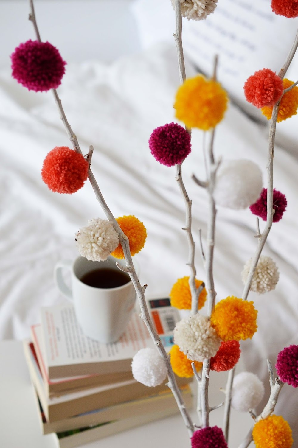 Im a wee obsessed with pom poms and this DIY is its perfect to brighten up any room!
