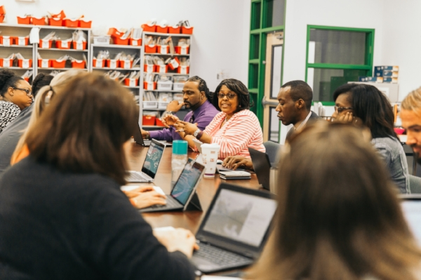 Turner leads a staff meeting with some of her 18 curriculum specialists, who are responsible for helping teachers develop lesson plans that achieve desirable student achievement goals.  Photo by Noah Turley.