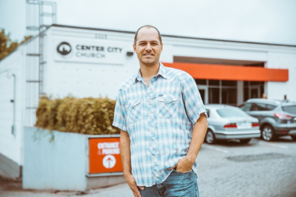 David Docusen stands in front of the Movement Center, the new home of Center City Church, and very different from the affluent area it came from. Photo by Noah Turley.