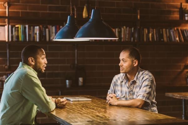 David meets with Dionte Grey, site director for Urban Promise, a youth-centered after school program that operates inside the Movement Center. Photo by Noah Turley.
