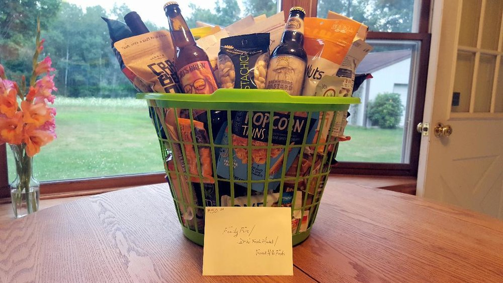 """Living Well"" Basket from Family Fare. Filled with numerous MI made items, including Founders, North Peak, Black Star Farms, Ferris Coffee and Nut, and much more! Perfect for an end of summer trip or get together."