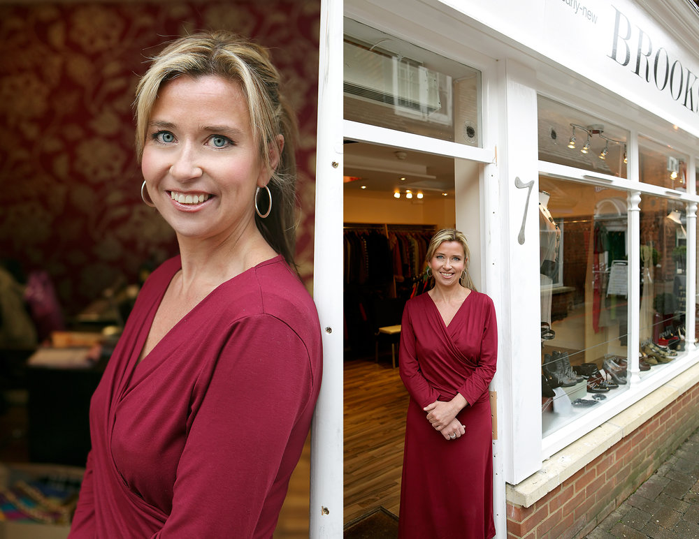portrait of businesswoman outside her shop
