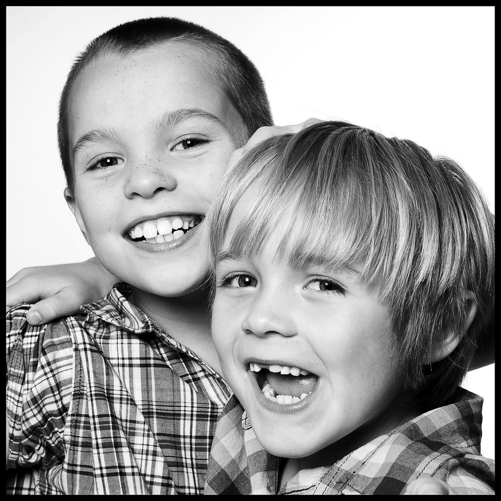smiling portrait of two young brothers