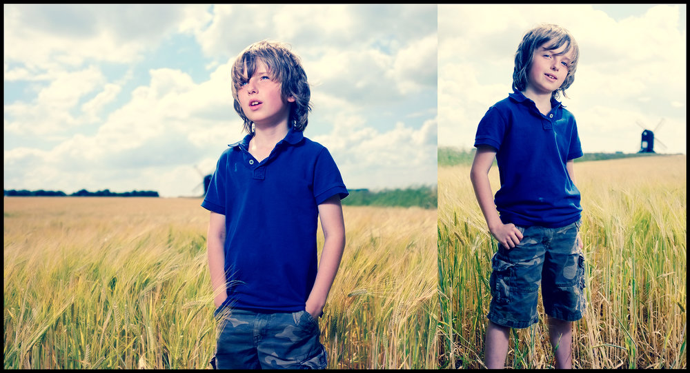 portrait of a boy standing in a field