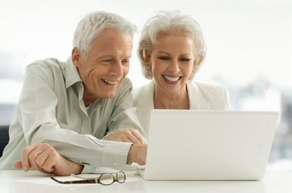 Elderly Couple at Computer