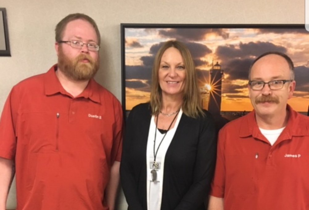 From left are Dustin Baker, Shelly Simmons and Jimmy Pickell, who all helped Mr. Rowell move into his new home in early February.