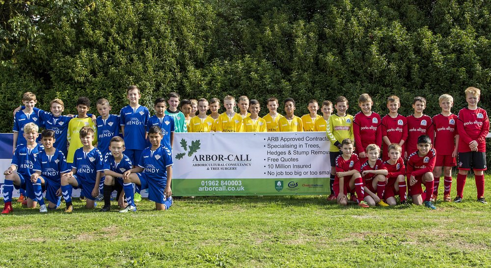 A fantastic photo of the team next to our Arbor Call banner!