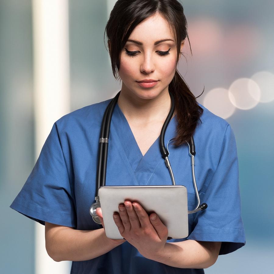bigstock-Portrait-of-a-nurse-using-a-di-101730137.jpg
