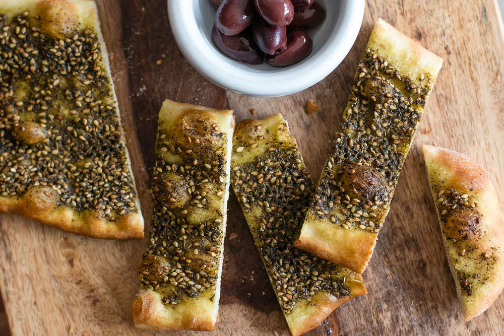 Manakeesh - Zina's Manakeesh are freshly baked on our home-made dough and served with wonderful toppings – experience amazing!! Zina's Manakeesh go nicely with Tapas and Mezza for a nice light dinner…