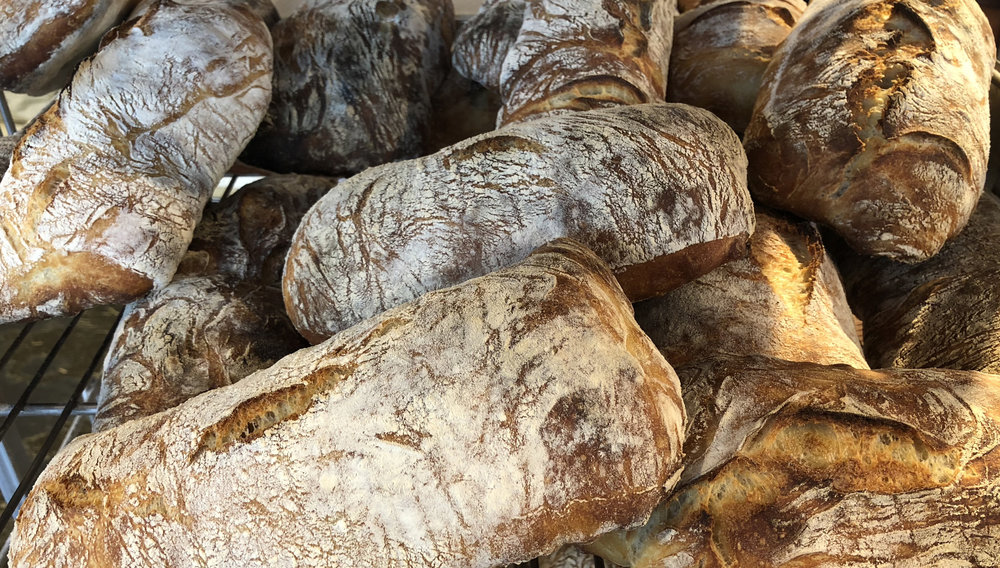 The transitive property of our bread:  Our bread = made by us.  We = local.  Therefore, our bread = local.