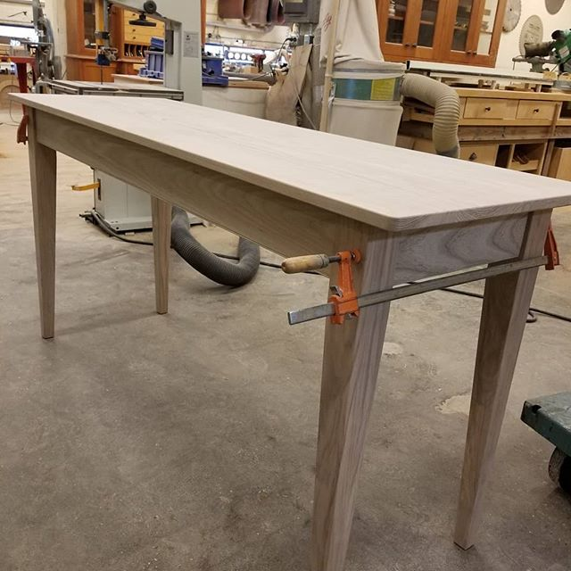 Dennis made a table! And we wanted to share 😁 A client came in and asked for a table to be used for folding laundry so we got to work and built this solid ash workspace. . . . If you can dream it, let us build it! . . . Homestead Cabinetmakers  www.welovewoodworking.com  Custom Furniture & Cabinetry made in downtown Kalamazoo, Michigan #laundry #customdesign #customfurniture #handmade #homedecor #woodworkersofmichigan #puremichigan #handmade #designspace #woodshop #woodworking