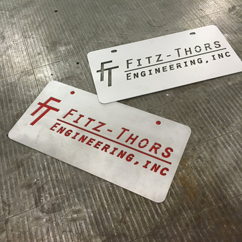 Fitz-Thors-Engineering_manufacturing_waterjet_logo_license-plates.JPG