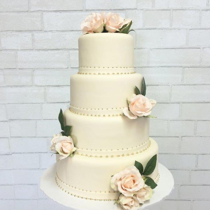 Katella Bakery four tear wedding cake with real flower arraignments