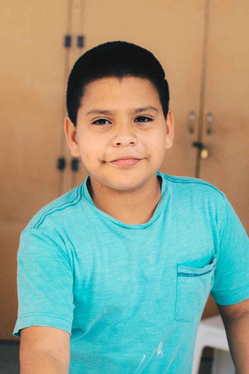 "Isaac C. - Sponsorship Status: Fully sponsoredBirthdate: September 18, 2008 (age 10)Grade: 5thParticipant Since: August 8, 2016What I Like to Do: Watch movies, play soccer, sleep, and ride my bikeMy Favorite Subject at School: MathMy Favorite Color: BlueMy Favorite Food: Encebollado – a soup made with fish, onion, and yucca root and served with dried plantain chips and fresh limeWhen I Grow Up: ""I want to be a teacher, because I like to teach others and learn at the same time.""My Favorite Part of Bonsai: The food and the play timeBackground: Isaac is friendly and energetic. He loves a good joke and provides a lot of humor at Bonsai. He lives in Manta with his mother and younger sister, Korina. In 2015, Isaac's older brother, who was born with a disability, died suddenly. This has been very painful for him and his family. We came to know Isaac's family through the food pantry ministry of Iglesia Bíblica Bautista de Manta (Bible Baptist Church of Manta), where Bonsai is hosted. The leadership of the church later recommended his family for participation in Bonsai. Isaac's father partially supports the family, but does not live with them. In June of 2017, Isaac's mother, Maura, started working with Bonsai as our part-time cook and put her faith in Jesus shortly after. Before he started attending Bonsai, Isaac's mother told us that he had dealt with a lot of bottled-up anger and hurt due to the loss of his brother, but we've seen him grow in his ability to laugh and express his emotions in a healthy way."