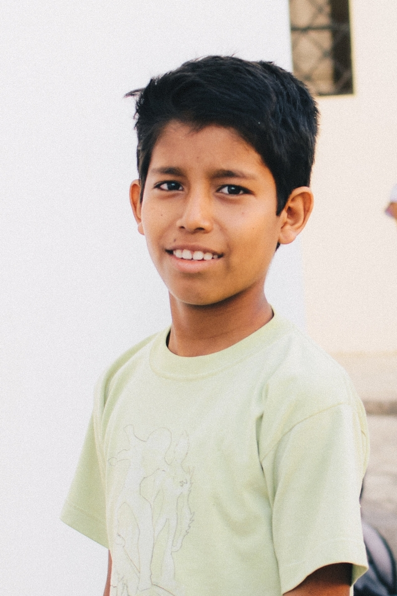 "Jean Carlos F. - Sponsorship Status: Fully sponsoredBirthdate: September 19, 2006 (age 12)Grade: 6thParticipant Since: October 17, 2016What I Like to Do: Play soccer, swim, and play tagMy Favorite Subject at School: ScienceMy Favorite Color: BlueMy Favorite Food: Corviches, which are pastries made with a batter of plantain and ground peanut, stuffed with fish, then baked or friedWhen I Grow Up: ""I want to be a taxi driver because I want to drive and have my own car.""My Favorite Part of Bonsai: Playing with his friendsBackground: Jean Carlos is bright, fun and helpful. He's well-rounded and is always eager to learn something new. When we met Jean and his family, they were living in a tiny patchwork cane house on the outskirts of Manta with his parents and four siblings. His father collects recyclables and works odd jobs to support the family. His mother washes and folds clothing to provide additional income, but before becoming a part of Bonsai the work frequently forced her to leave Jean and his siblings at home alone. Neither of Jean's parents can read or write, which made helping the children with their homework virtually impossible. Now that the family is participating in Bonsai, Jean's parents can work unhindered and the kids are receiving help with homework and tutoring. Some of our short-term teams were also able to help us build a new house for Jean's family. Jean was closed-off and untrusting when he started at Bonsai, but is now very friendly and a leader among his peers. He has also gotten much more responsible and careful in his work, and has caught up to grade level."