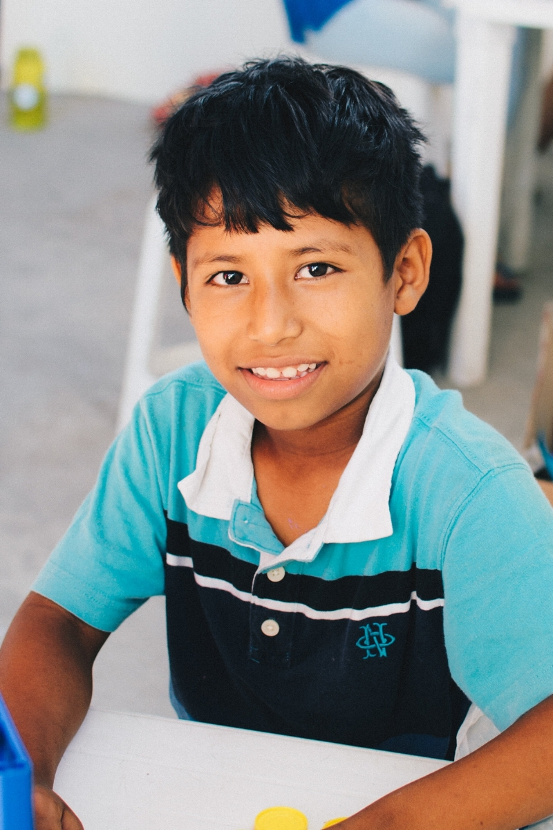 "Manuel F. - Sponsorship Status: Fully sponsoredBirthdate: September 12, 2008 (age 10)Grade: 3rdParticipant Since: October 17, 2016What I Like to Do: Play tag, play soccer, and go to the mallMy Favorite Subject at School: LanguageMy Favorite Color: YellowMy Favorite Food: Encebollado – a soup made with fish, onion, and yucca root and served with dried plantain chips and fresh limeWhen I Grow Up: ""I want to be a policeman so I can help people.""My Favorite Part of Bonsai: Drawing and coloringBackground: Manuel is sweet and fun. He is always eager to please and help out. When we met Manuel and his family, they were living in a tiny, patchwork cane house on the outskirts of Manta with his parents and four siblings. His father collects recyclables and works odd jobs to support the family. His mother washes and folds clothing to provide additional income, but before becoming a part of Bonsai the work frequently forced her to leave Manuel and his siblings at home alone. Neither of Manuel's parents can read or write, which made helping the children with their homework virtually impossible. Now that the family is participating in Bonsai, Manuel's parents can work unhindered and the kids are receiving help with homework and tutoring. Some of our short-term teams were also able to help us build a new house for Manuel's family."