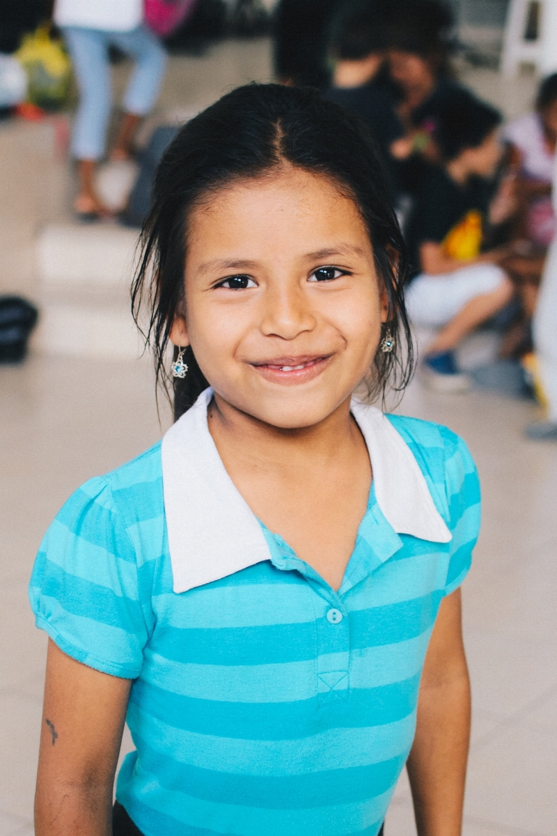 "Valentina F. - Sponsorship Status: Fully sponsoredBirthdate: September 20, 2010 (age 8)Grade: 2ndParticipant Since: October 17, 2016What I Like to Do: Help my mom clean, play Uno, and go to the parkMy Favorite Subject at School: MathMy Favorite Color: PurpleMy Favorite Food: Encebollado – a soup made with fish, onion, and yucca root and served with dried plantain chips and fresh limeWhen I Grow Up: ""I want to be a teacher so I can teach children, and so I can teach English.""My Favorite Part of Bonsai: PlayingBackground: Valentina is playful and loving. She enjoys singing, coloring and having her picture taken. When we met Valentina and her family, they were living in a tiny, patchwork cane house on the outskirts of Manta with her parents and four siblings. Her father collects recyclables and works odd jobs to support the family. Her mother washes and folds clothing to provide additional income, but before becoming a part of Bonsai the work frequently forced her to leave Valentina and her siblings at home alone. Neither of Valentina's parents can read or write, which made helping the children with their homework virtually impossible. Now that the family is participating in Bonsai, Valentina's parents can work unhindered and the kids are receiving help with homework and tutoring. Some of our short-term teams were also able to help us build a new house for Valentina's family."