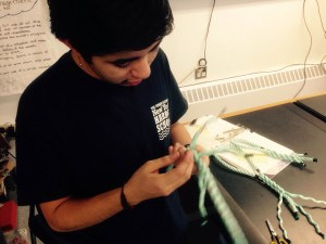 Michael, a junior, working on the eye splice.
