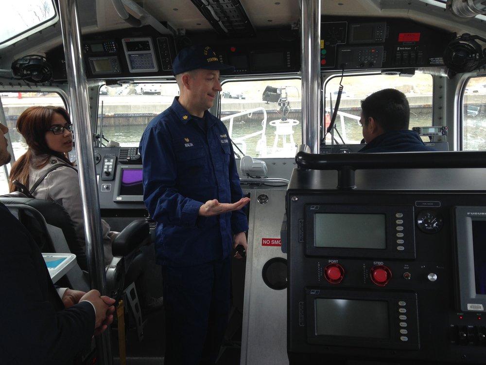 Steven Fernandez, Waleska, Lt. Cmdr. Walsh, and Luis in USCG vessel.