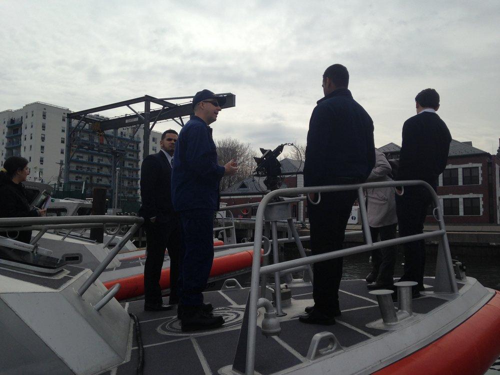 On Board a Response Boat: Steven Fernandez, Lt. Cmdr. Walsh, Luis, Waleska, Brendan.
